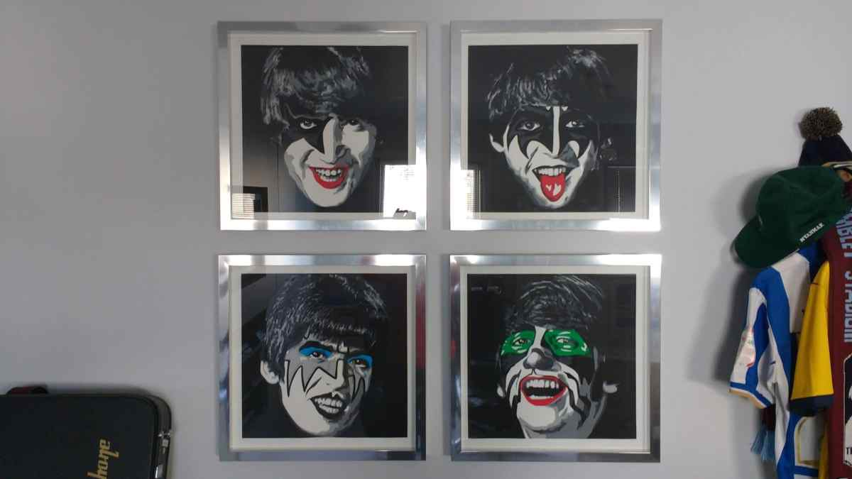 Guitars stacked below, The Beatles hanging above. We installed these silver framed prints in a grid formation.