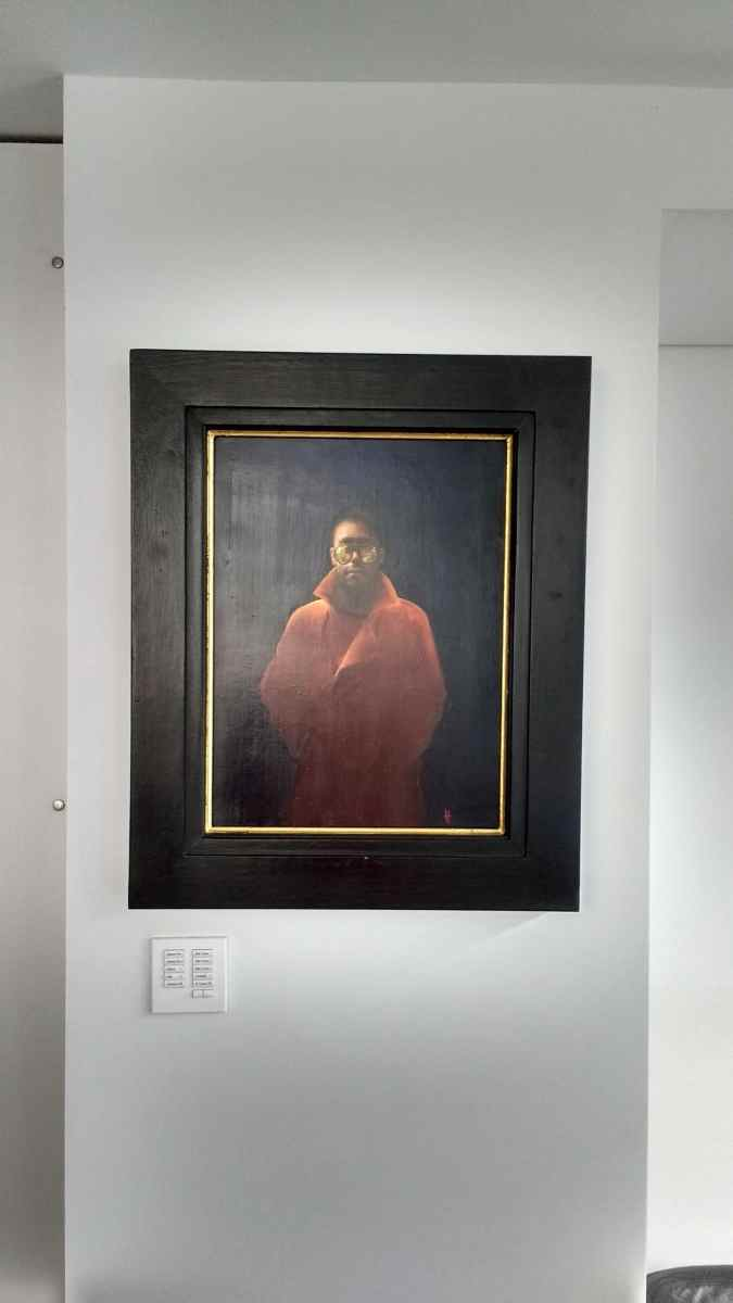 'Our Man in Orange' by Kevin Hendley, hung in a basement room in Brighton.