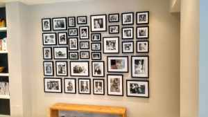 39 family photos hung in a rectangle in a home in Hammersmith, London.