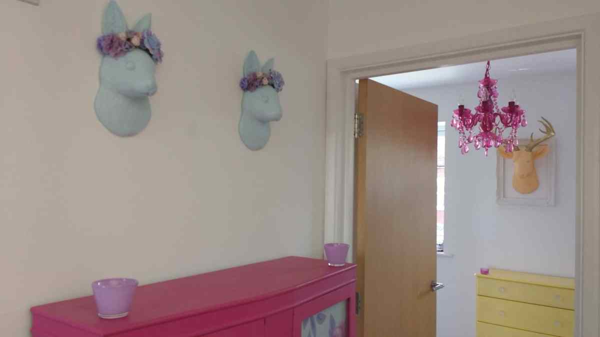 Pastel coloured animal busts in a kitsch home in Brighton.