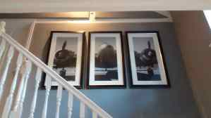 A black and white airplane triptych hung above the stairs in a home in Islip.