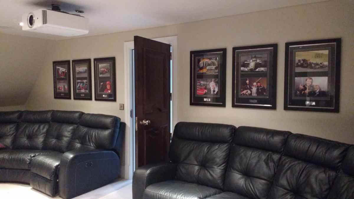 Six Formula One pictures hung in a cinema room in Surrey.