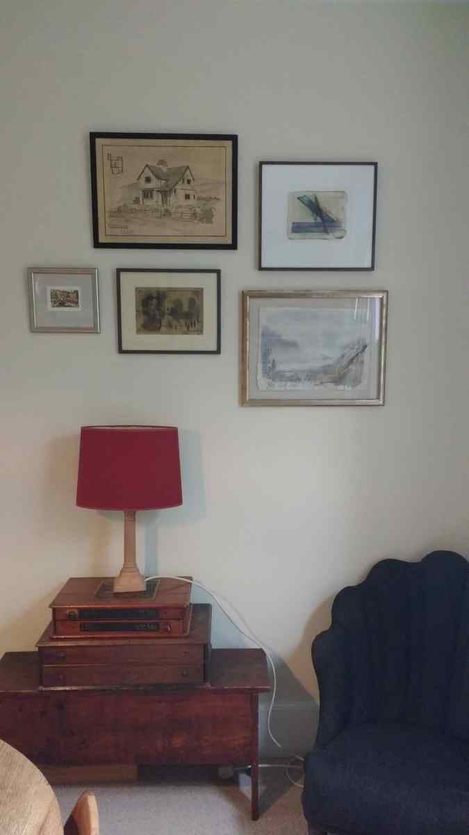 Six pictures arranged in a home in Tuffnel Park, London.
