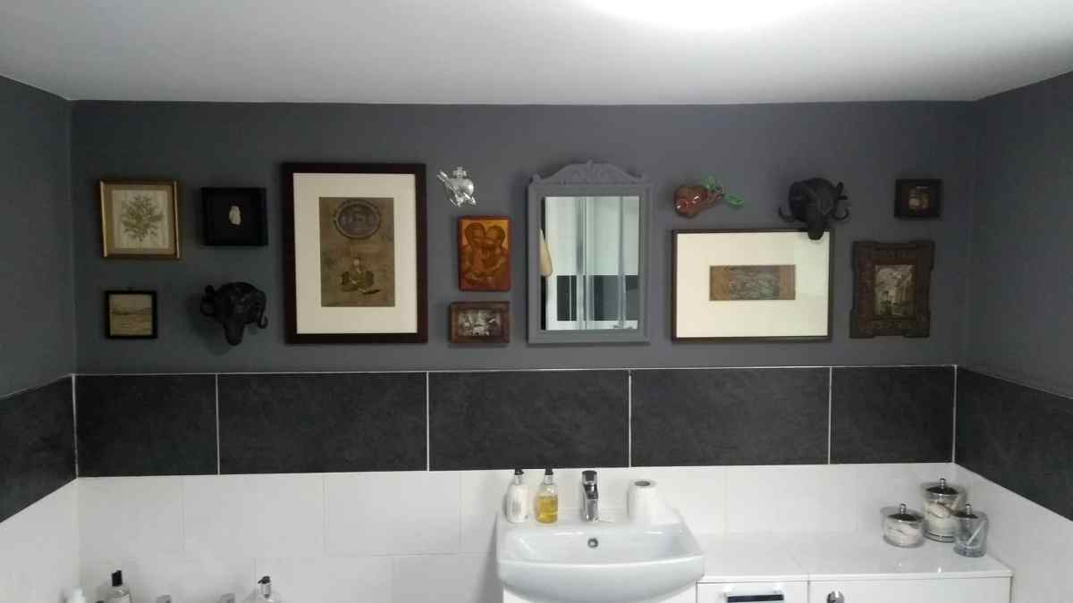A collage wall arranged in a bathroom in Brighton.