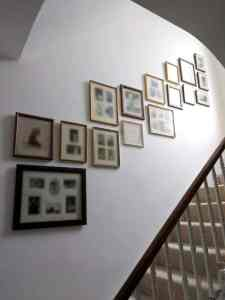 A sepia collage wall running up the staircase in a home in Richmond.