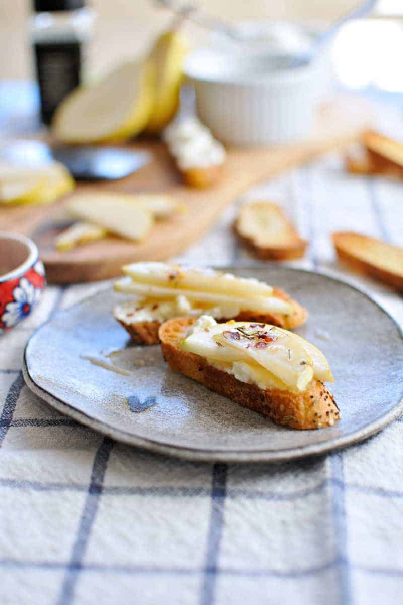 10-Minute Pear + Ricotta Crostini with Honey + Thyme | the pig & quill | #recipe #thanksgiving #appetizer #snack
