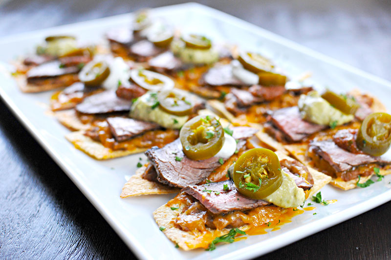 Crunchy baked chips, super addicting carne asada and all the fixins'! (via thepigandquill.com)