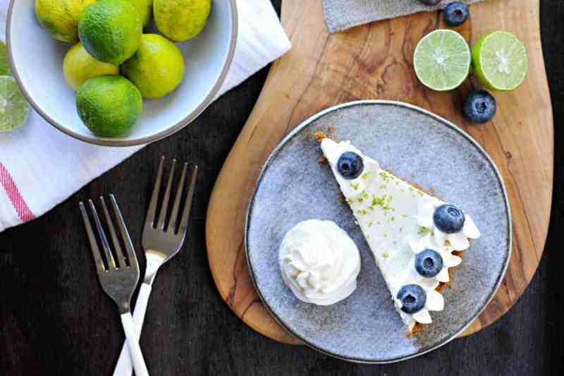 blueberry key lime cheesecake tart with gingersnap crust recipe via thepigandquill.com | #baking #sweets #dessert #summer