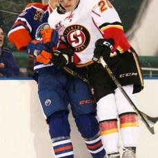 Austin Carroll (20) checks Dillon Simpson