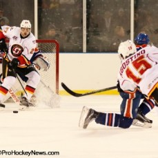 Derek Grant (27) looks to tip a shot from Kenny Agostino (15)