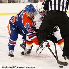 Josh Currie (36) and Freddie Hamilton (11) fight for puck during faceoff
