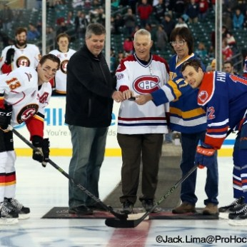 (Left to Right) Turner Elson-Heat, Mike Sophis, Terry Harper, Steve Carlson and Ryan Hamilton participate in the Ceremonial Puck Drop