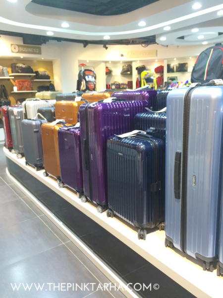 More hard-shell luggage in jewel tones.