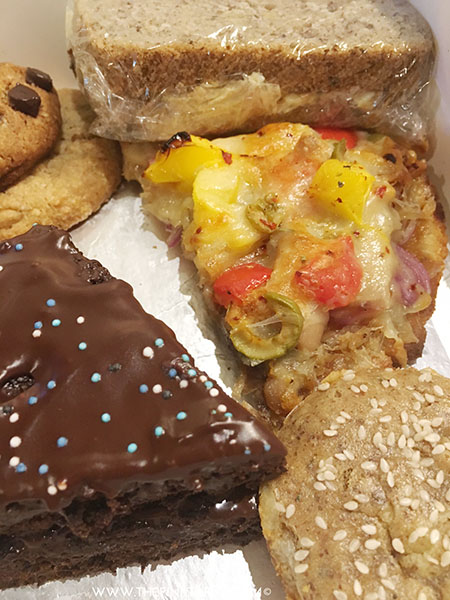 Top to Bottom, clockwise: Cookies, Chicken sandwich, pizza slice, dinner roll, chooclate cake