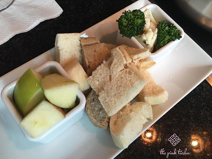 Dippers for the cheese fondue: green apples, bread, broccoli and cauliflower.