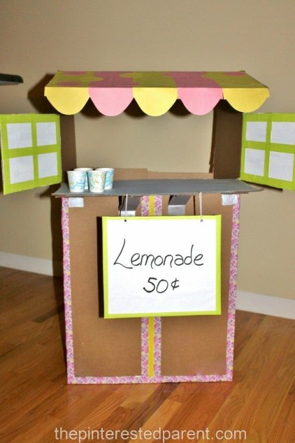 Don't toss your old cardboard boxes. Upcycle them into fun.Cardboard box lemonade stand for the kids