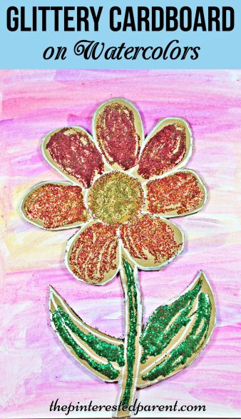 Glittery cardboard flower over watercolor paints - a pretty spring or summer arts & crafts project for kids.