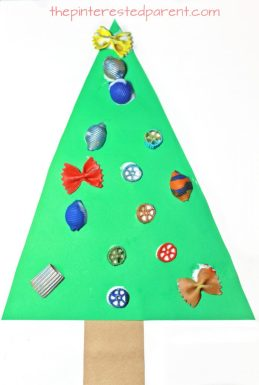 Painted pasta ornaments make the perfect decoration for this adorable Christmas tree craft. Holiday and winter arts and crafts and activities for preschoolers & kids.
