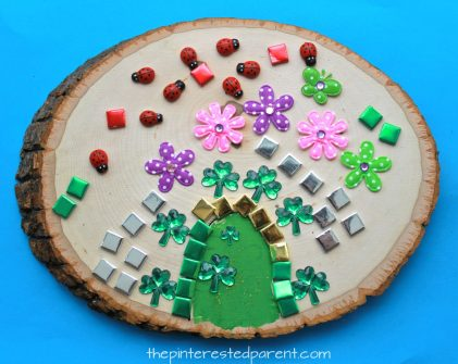 Wood Slab Leprechaun house and door. St Patrick's Day arts and crafts for kids. Paint, stickers, nature and gemstones made these pretty doors.