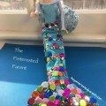 Use an old tube sock and some sequins to make this no sew mermaid tail for your Barbie. Arts and crafts for your kids