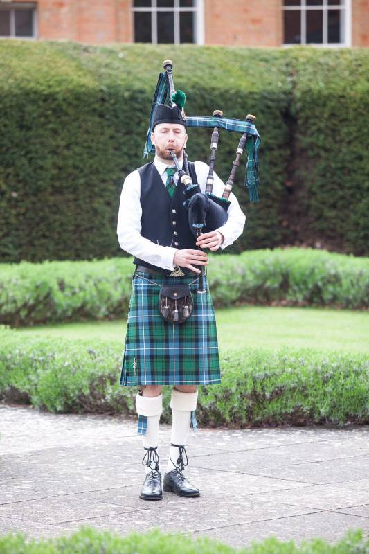 Image of Matthew McRae bagpiping at a wedding in Worcestershire