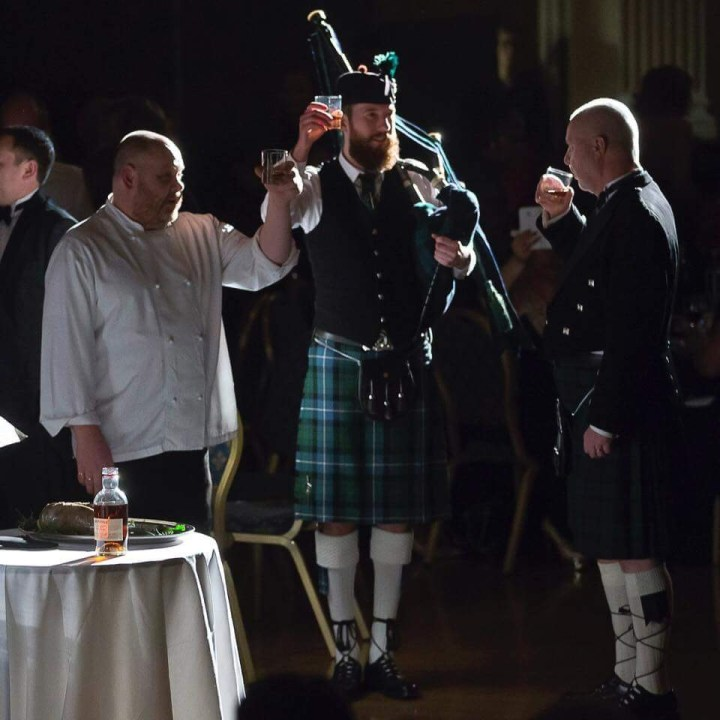 Image of Matthew McRae bagpiping at the Mayor of Newham's Burns' supper in London