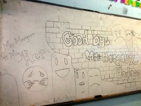 The left half of the white board decorated for me by one of my classes