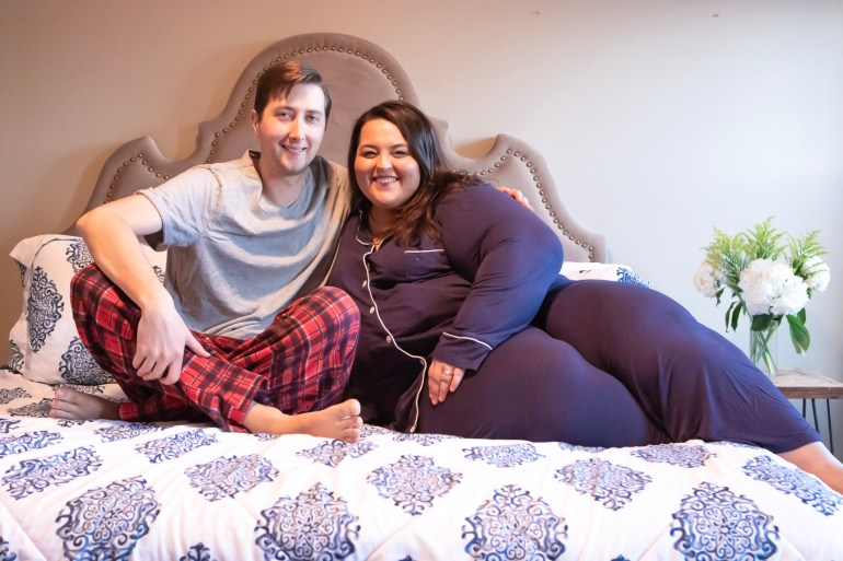 Miranda and Kevin Schultz of The Plus Life wearing pajamas on Big Fig Mattress