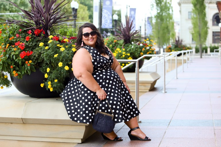 Miranda Schultz of The Plus Life Blog Wearing a Polka Dot Dress from Gwynnie Bee Subscription Service