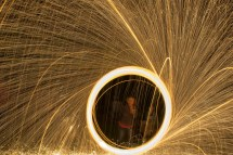 Smoldering steel wool on a string spun at high velocity creates a great light show!