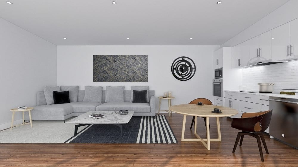 Wooden floors with white wall. White cabinet in the kitchen with some kitchen utensils. Round wooden table with two chairs. Carpet and ceramic table in the center. Sofa
