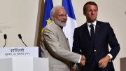 Modi with Emmanuel Macron shaking hands