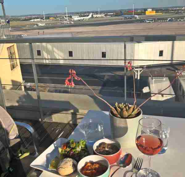 Snacks, wine and plane watching on the Cibeles VIP lounge terrace in T1. Photo by Lori Zaino / The Points Guy UK.