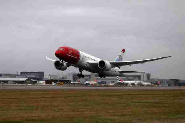 A Boeing Co. 737 passenger aircraft, operated by Norwegian Air Shuttle ASA, takes off at London Gatwick Airport in Crawley, U.K., on Tuesday, Jan. 10, 2017. Norwegian attracted 29.3 million passengers last year, a 14 percent increase that's likely to put it ahead of SAS AB's Scandinavian Airlines for the first time. Photographer: Simon Dawson/Bloomberg via Getty Images