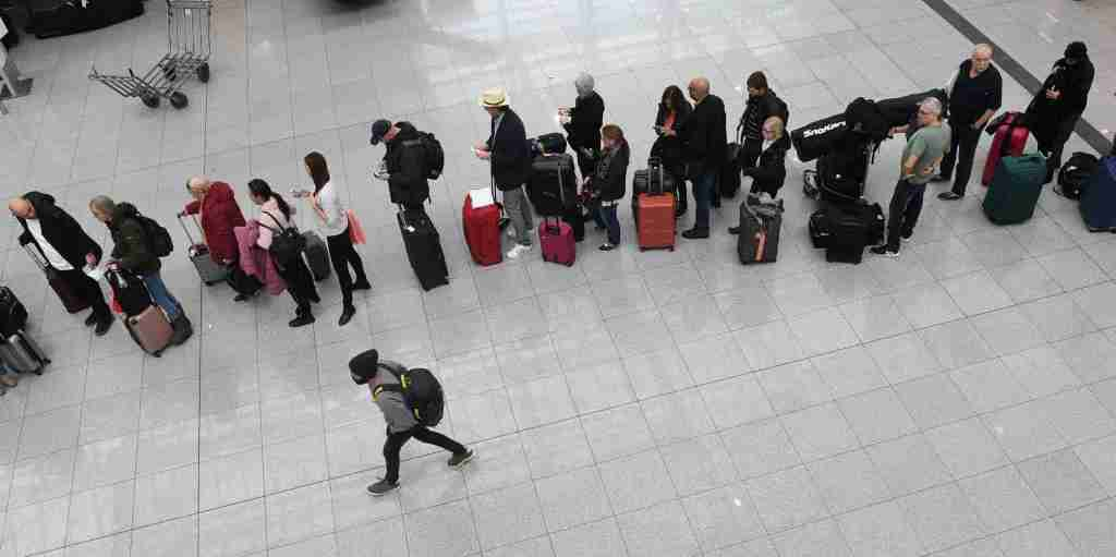 Passengers wait in line at counters of the German airline Lufthansa at the Franz-Josef-Strauss airport in Munich, southern Germany, on February 10, 2020. - Germany hunkered down on February 09 and 10, 2020 for a powerful storm expected to disrupt air, rail and sea links, cancel sports events, cut electrical power and damage property. With howling winds and driving rain, forecasters said Ciara would also hit France, Belgium, the Netherlands, Switzerland and Britain. (Photo by Christof STACHE / AFP) (Photo by CHRISTOF STACHE/AFP via Getty Images)