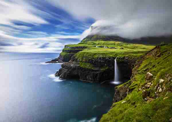 Mulafossur waterfall in the Faroe Islands. (Photo by Haitong Yu/Getty Images)