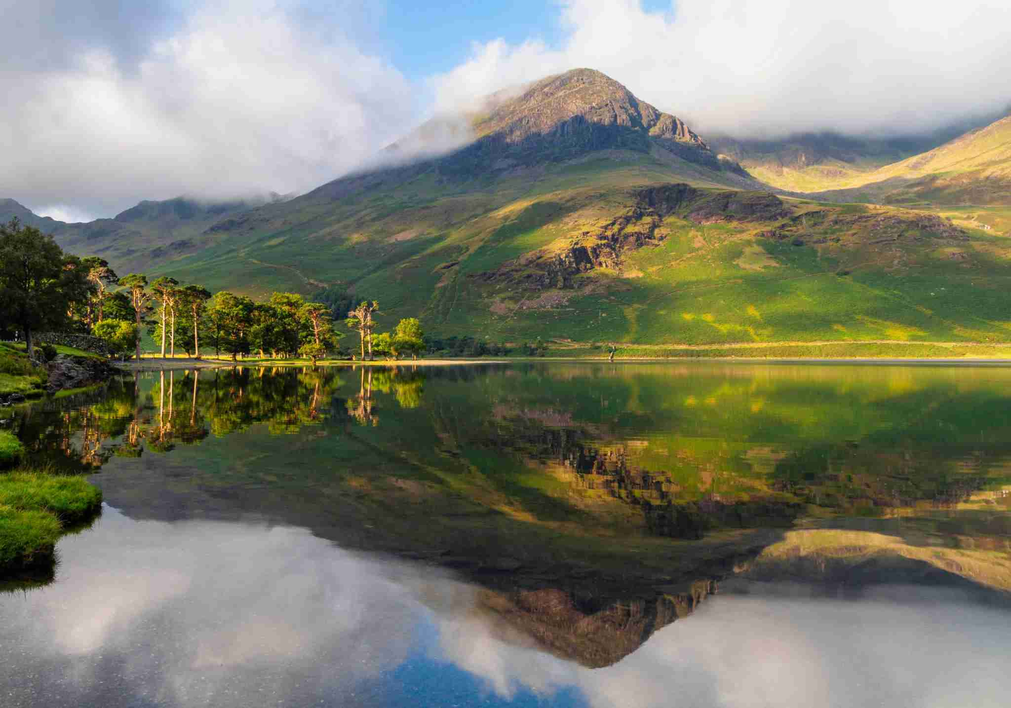 Dawn breaks over Buttermere, in the English Lake District. (Photo by simonbradfield/Getty Images)
