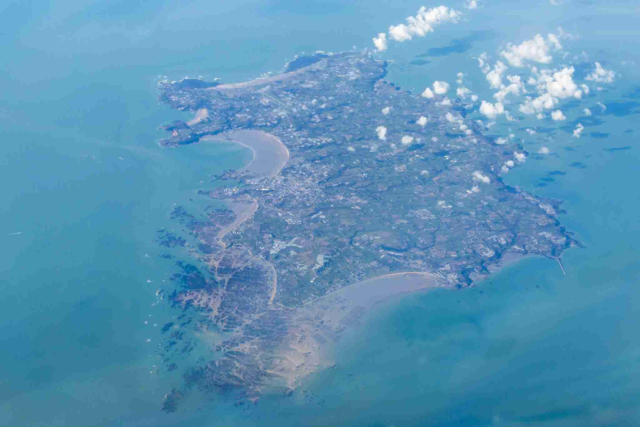 A photograph of the whole island of Jersey, taken from the flight deck of an airplane