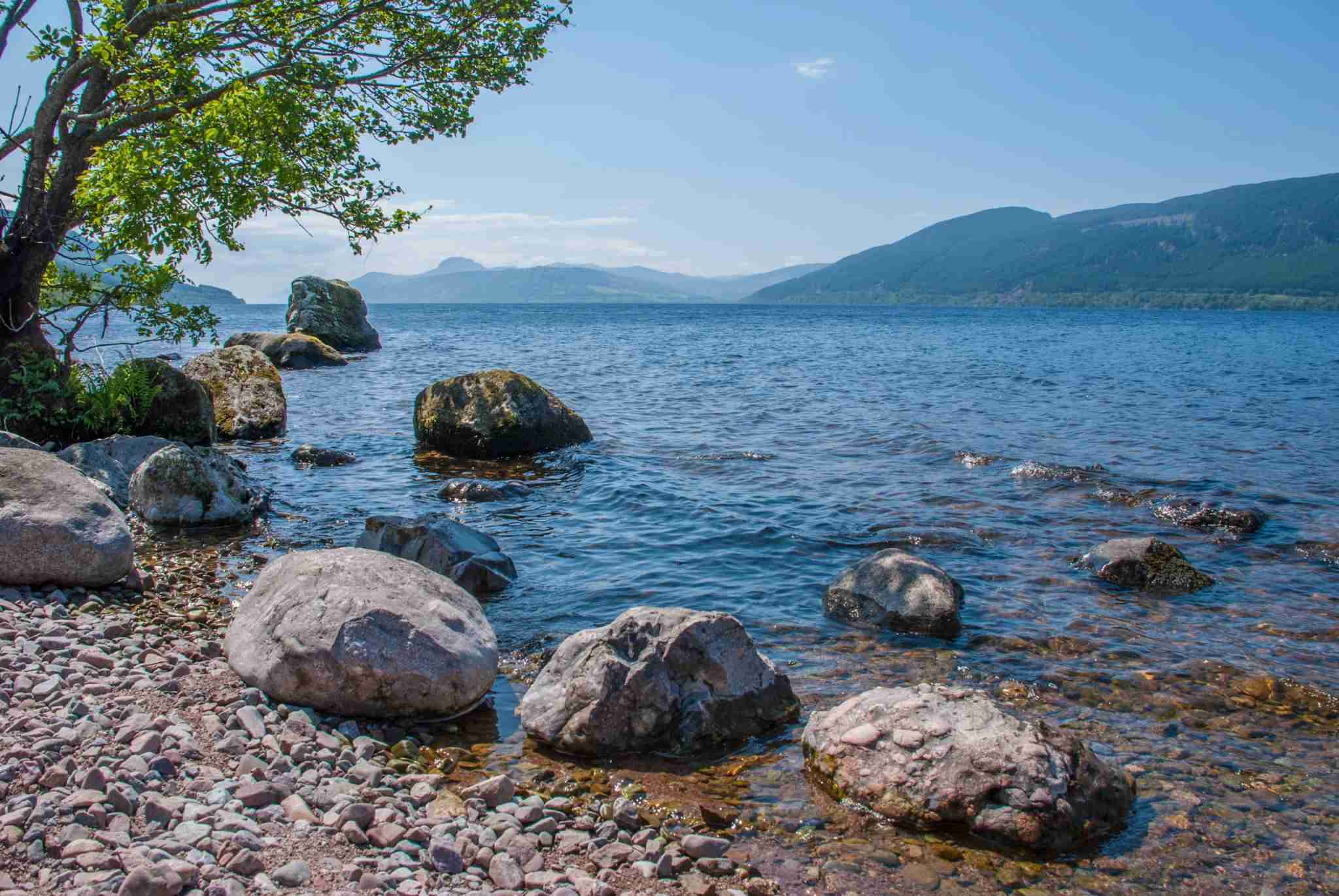 Lakeside view of Loch Ness under blue skies with distant clouds in summertime, Loch Ness, Fort Augustus, Scottish Highlands, Scotland, Uk, Europe (Photo by Eve Livesy/Getty Images)