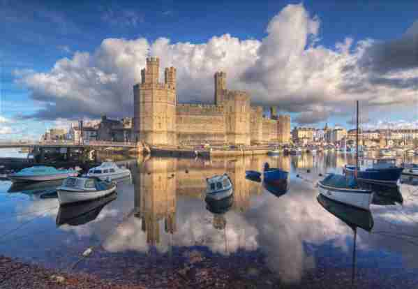 Majestic Caernarfon castle in North Wales. Photo by PayPal / Getty Images