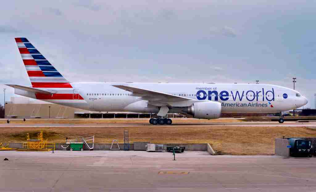 DALLAS, TEXAS - DECEMBER 12, 2018: An American Airlines Boeing 777 (Oneworld livery) passenger jet taxis after landing at Dallas/Fort Worth International Airport which serves the Dallas/Fort Worth, Texas, metroplex area in Texas. Oneworld is a alliance of airlines designed to serve frequent international travelers. (Photo by Robert Alexander/Getty Images)
