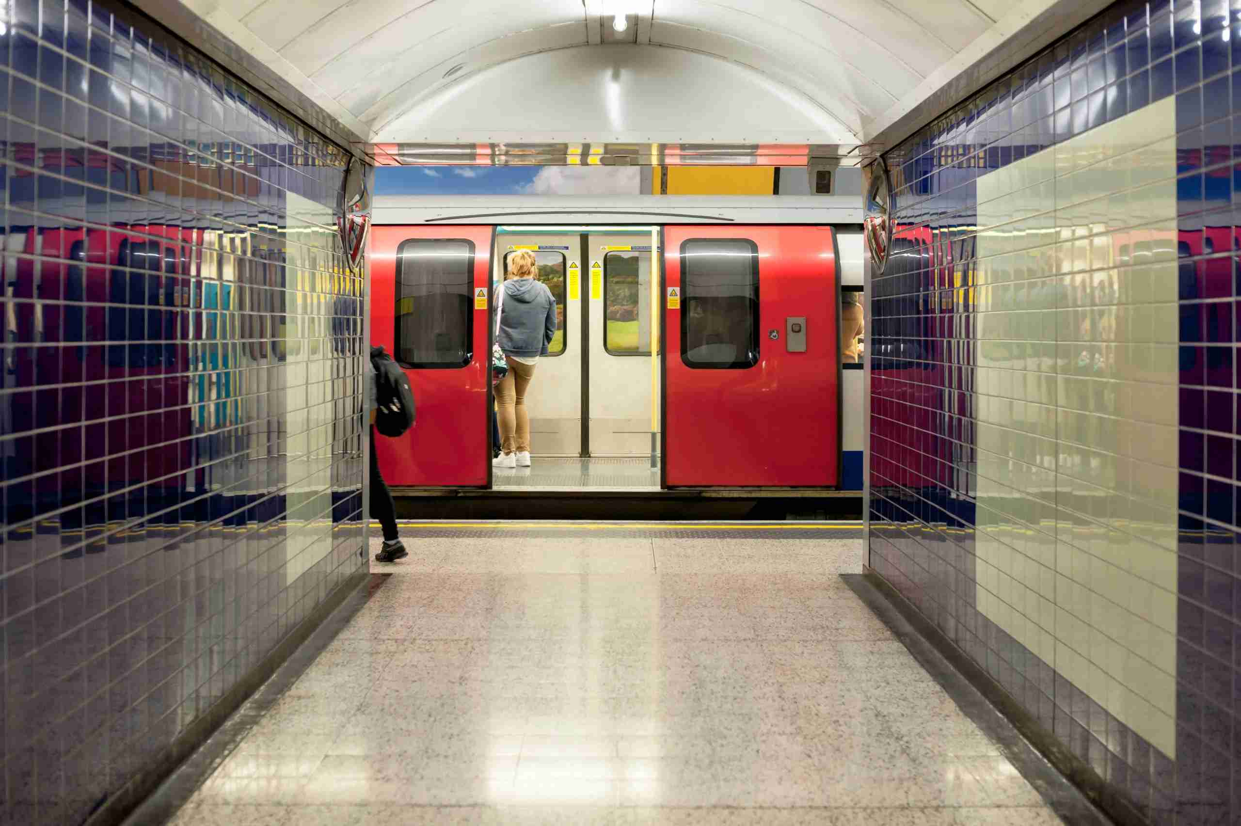A tube train standing at the station with the door open, London, UK.