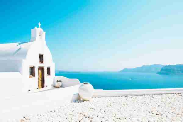 Oia, Santorini, Greece. Beautiful byzantine Orthodox church over the sea (Photo by Westend61/Getty Images)