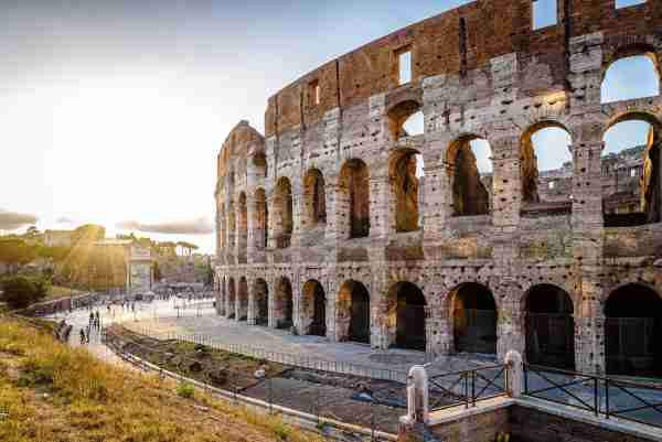 Outdoor view of The Colosseum or Coliseum, also known as the Flavian Amphitheatre. It is an oval amphitheatre in the centre of the city of Rome (Photo by @JJFarquitectos via Twenty20)