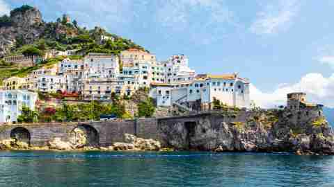 panoramic view of small haven of amalfi village with tiny beach and colorful houses located on rock t20 xXBwg2 scaled