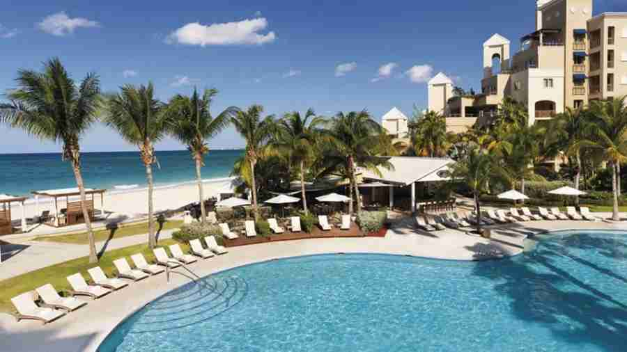 The main pool at the Ritz overlooks Seven Mile Beach. Photo courtesy The Ritz Carlton