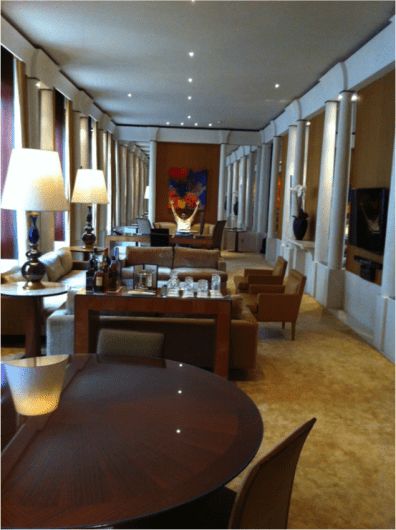The enormous living room of the Imperial Suite at the Park Hyatt Paris Vendome; that's me with my hands up at the far end!