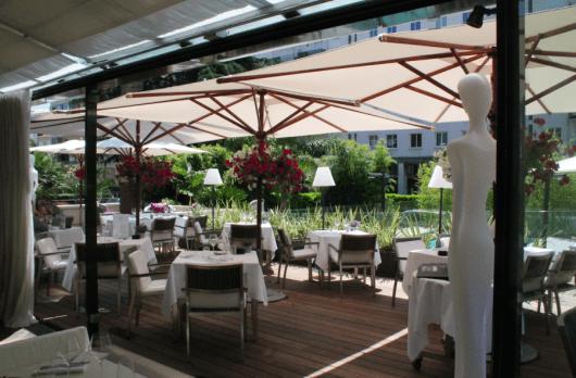 Outdoor terrace restaurant/bar at Hotel La Canberra