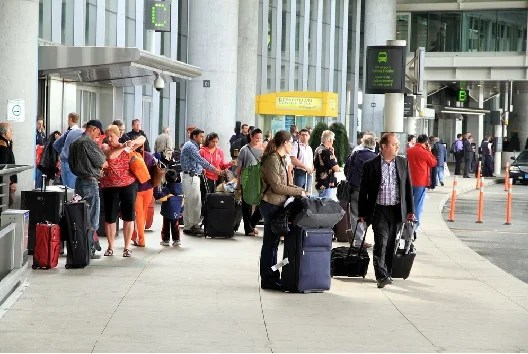 Airport pickup areas can be crowded, but there is no reason why you can't pick someone up at departures. Image courtesy of Shutterstock.