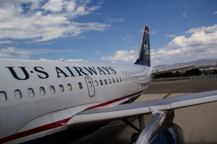 You might be seeing these planes until late 2016, but all US Airways flights will now be listed as American Airlines.